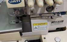Швейная машинка. пятинитка промышленная